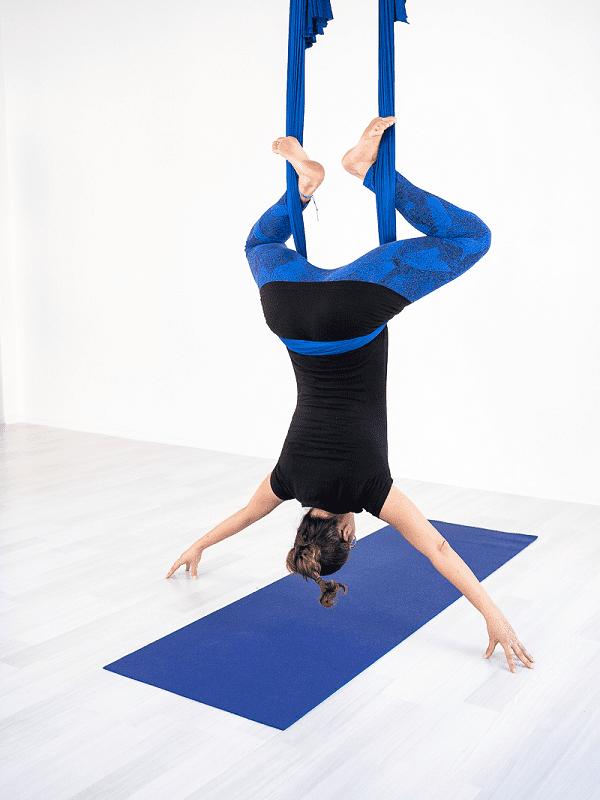 Aerial yoga back straddle position