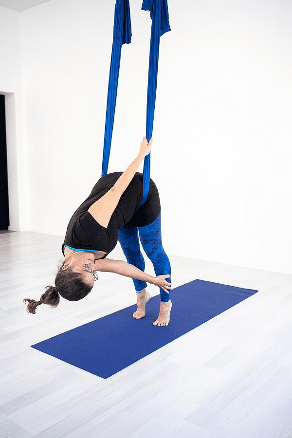 Aerial yoga hip hang twist